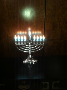 Menorah with all the candles lit - marking the 8th night of Hanukkah (taken in my building, not at the party)